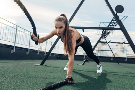 Muscular woman working out