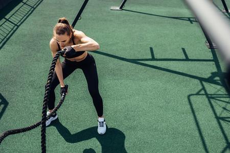 Young muscular woman exercising