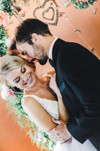 Bride laughing at groom