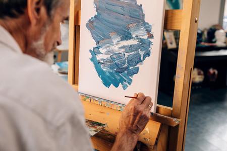 Senior artist making autograph