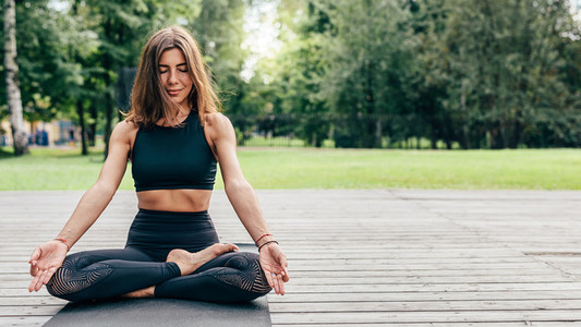 Young woman enjoying yoga