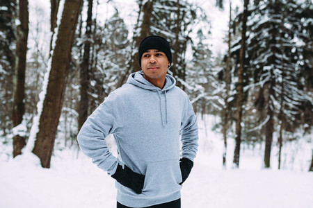 Athlete standing in a forest