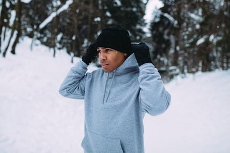 Sportsman standing in winter