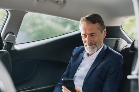 Businessman sitting in the car