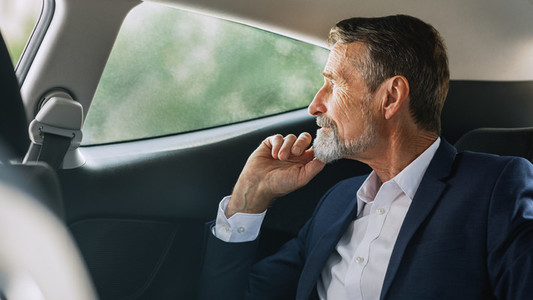 Side view of mature businessman