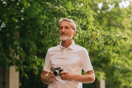 Mature photographer standing