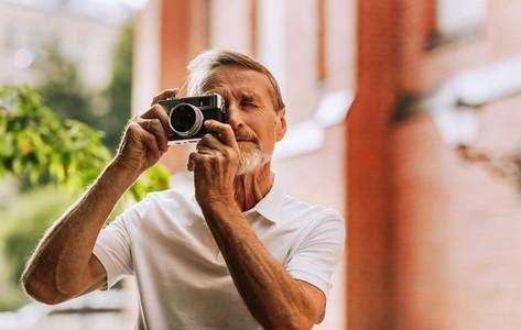 Portrait of senior photographer