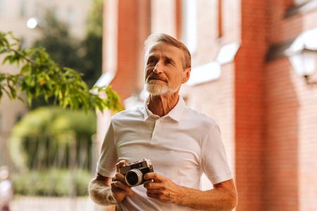 Tourist with the analog camera