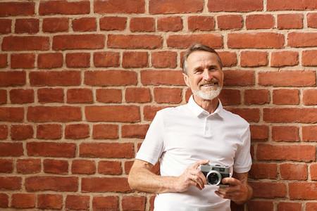 Smiling mature man looking at ca