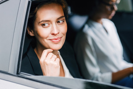 Smiling businesswoman in car