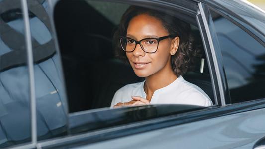 Beautiful businesswoman in car