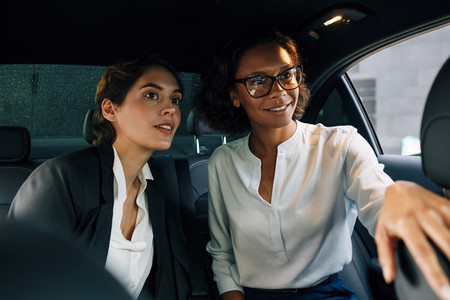 Two business colleagues in car