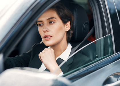 Beautiful businesswoman in car