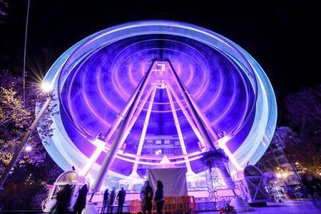 Ferris wheel at night at the fair in Granada