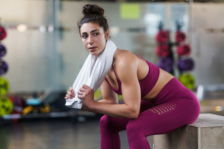 Woman Resting After Exercises at the Gym