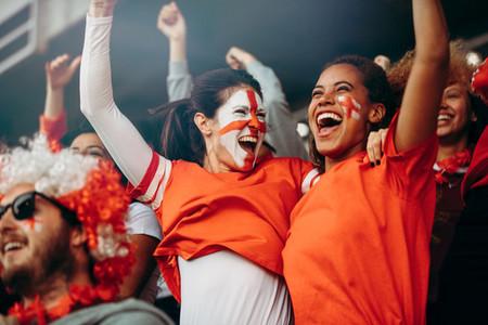 Female soccer fans celebrating championship win