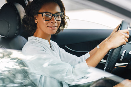 Young woman driving a car