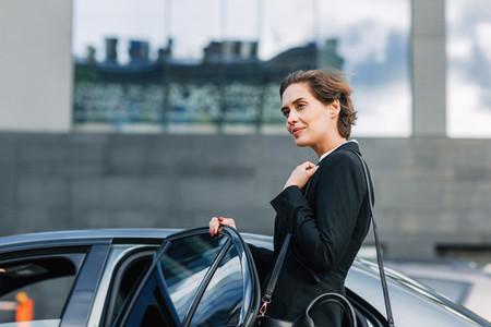 Businesswoman opening a door