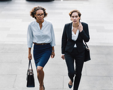 Two women in office wear