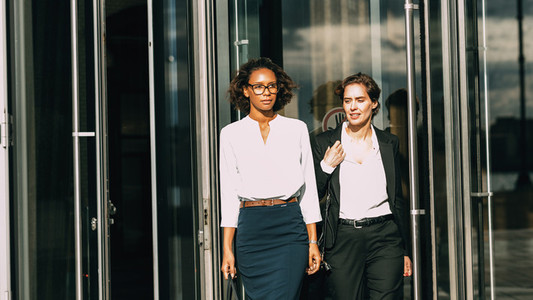 Two women out office building
