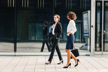 Two women commuting