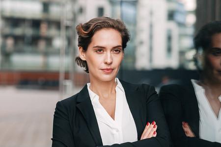 Confident businesswoman looking