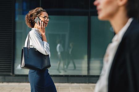 Woman carrying bag walking