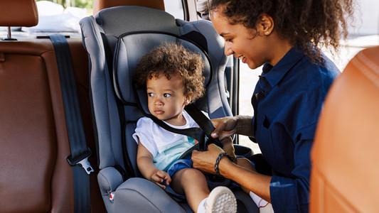 Little boy sitting in a seat