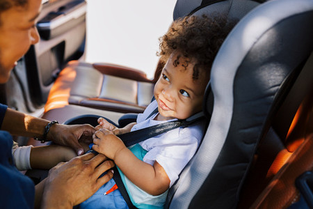 Smiling baby boy in car