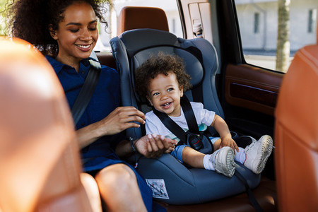 Happy kid sitting on a backseat