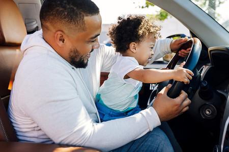 Shot of a little boy in car