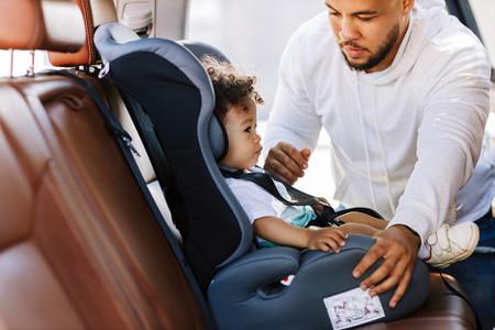 Young parent adjusting seat