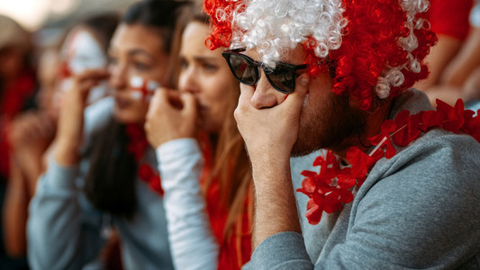 Unhappy and frustrated football fans at the stadium