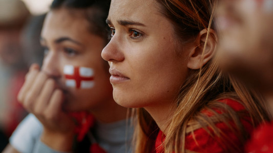 English sports fans looking upset during a football game