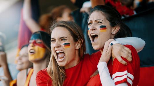 German spectators cheering at sports event