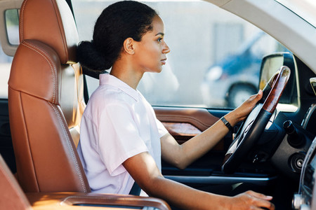 Confident young woman driving