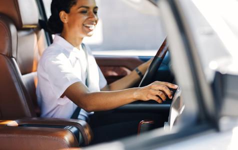 Woman driver touching dashboard