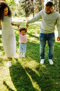 Happy family of three walking