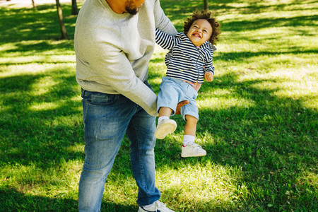 Man holding his son on hands