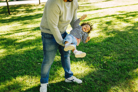 Father playing with baby son