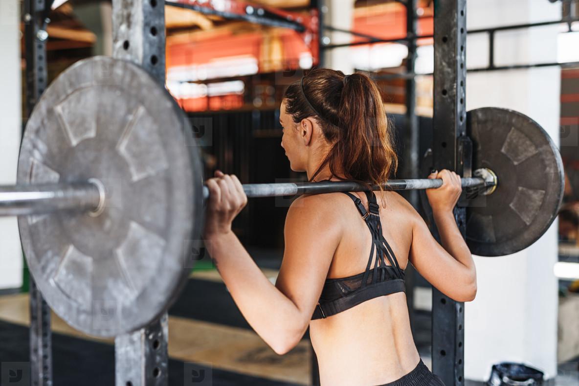 Sportswoman standing in gym