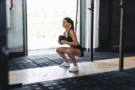 Fit woman doing squats