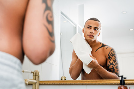Young man wiping face