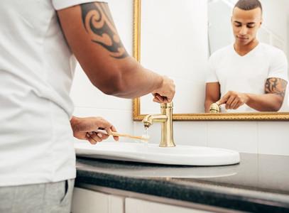 Young man washing his brush