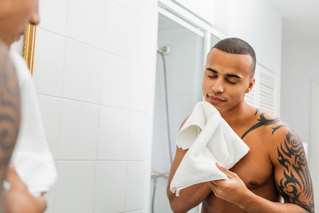 Handsome man holding white towel