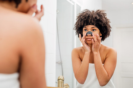 Woman applying nose patch