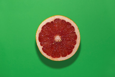 grapefruit on a green background