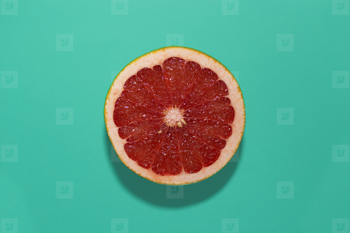 grapefruit on a turquoise backgr