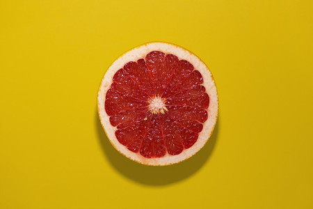grapefruit on a yellow backgroun