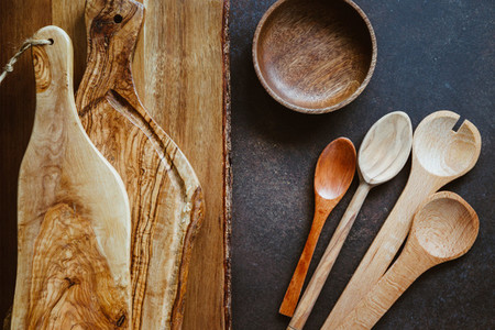 Top view of rustic wooden kitchenware Cutting boards and spoons Eco and natural cooking concept